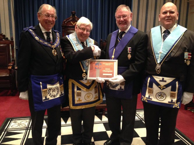 WEHA Chairman W. Bro. Alan Everard presents a Bronze certificate to W Bro Peter Burch
