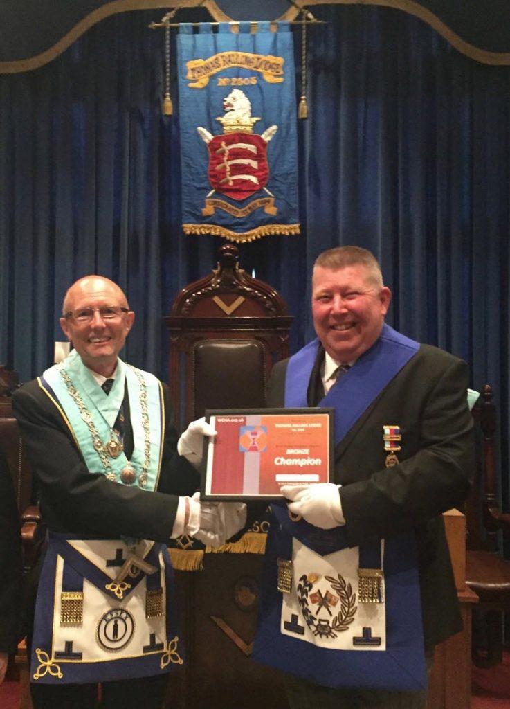 WEHA Secretary W Bro Tony Curtis PGStB presenting a Bronze certificate to W Bro Kelvin Stone PPJGW